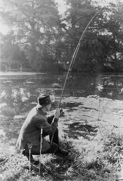 Dick Walker fishing with a rod of his own making